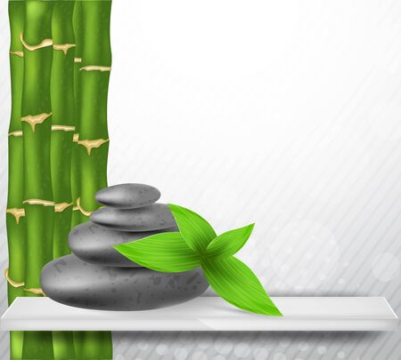 Zen stone with green bamboo and leaves photo