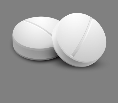 pills: Two pills isolated on gray background