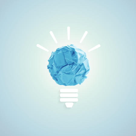 crumpled paper ball: Concept with bulb