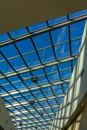 Glass roof of the shopping center, view from the inside