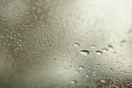 Selective focus and degradation of a background.Abstract texture background and drops of a rain on glass Reklamní fotografie