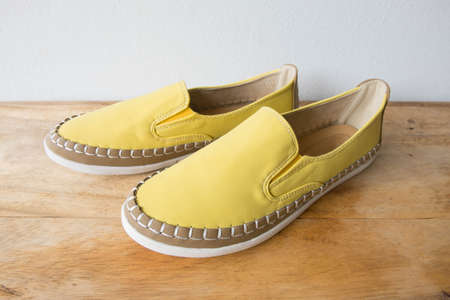 moccasin: Yellow moccasin shoes on wooden table