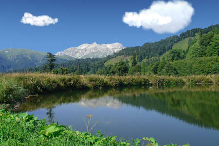 Mountain lake with clear water  Stock Photo