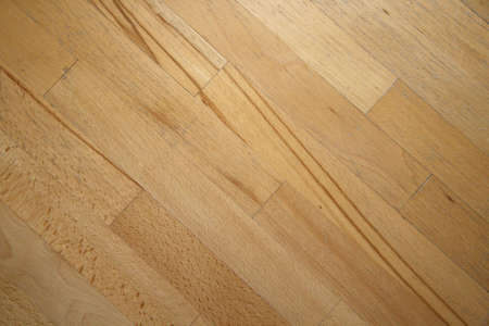 Used wooden parquet close-up background