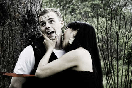 Woman biting man