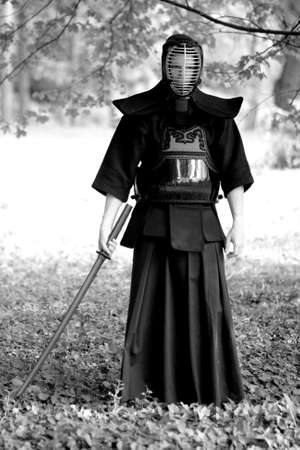 Samurai standing in the forest Stock Photo