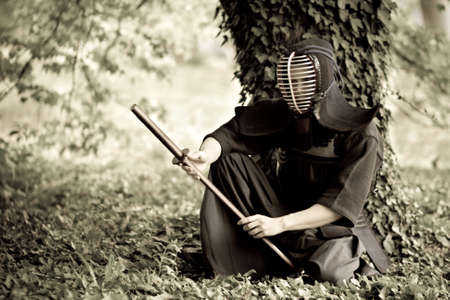 traditional weapon: Samurai sitting under the tree