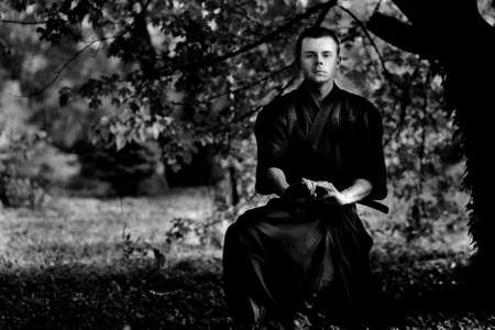 Samurai silhouette under the tree