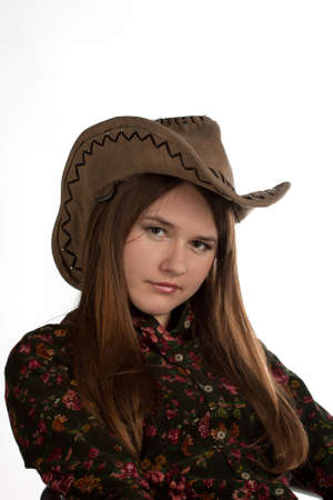 Attractive cowgirl portrait on white background Stock Photo