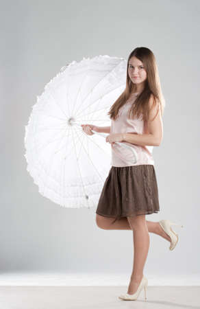 Girl standing with umbrella
