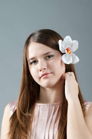 Shy girl with flower in hair