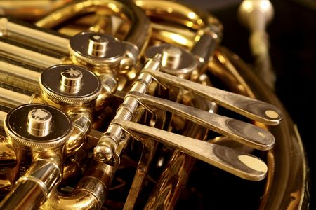 musical instruments: french horn on a black background