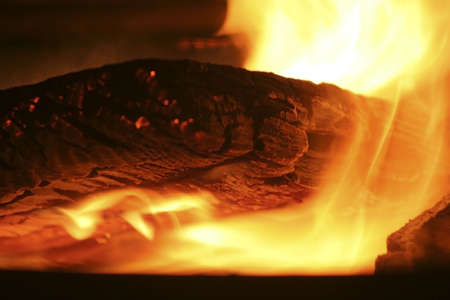 Detail of a flaming log in a campfire