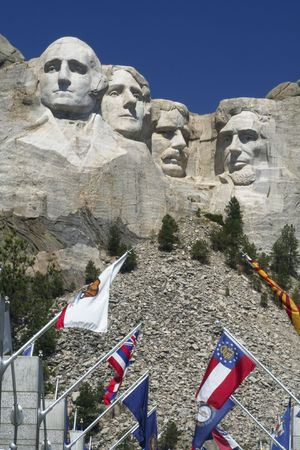 Mt. Rushmore and flags  on a clear summer day