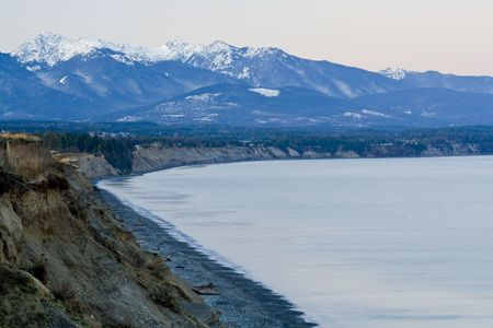 Beautiful winter dawn over the Olympic Mountains from the Dungeness Spit Stock Photo - 2726425