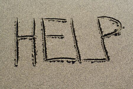Help spelled out on a beach Stock Photo
