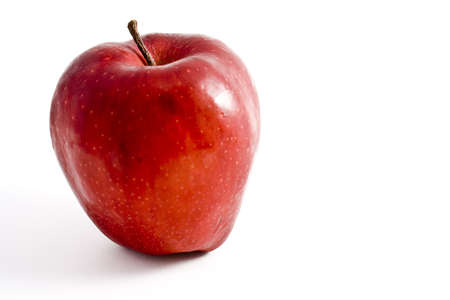 One ripe red apple on a clean white background