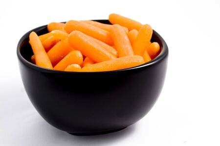 A bowl of carrots on a white background