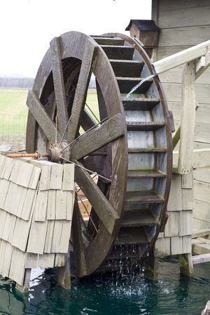 grist mill: A water wheel on a farm in rural Washington