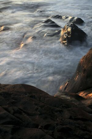 wavelet: Waves with motion blur on the rocks