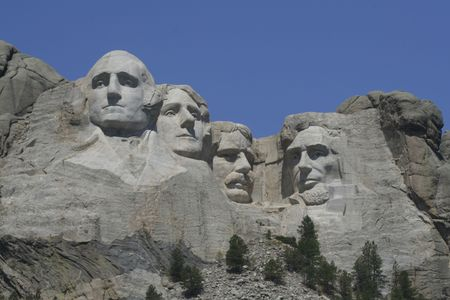 Mt Rushmore and some trees on a clear summer day