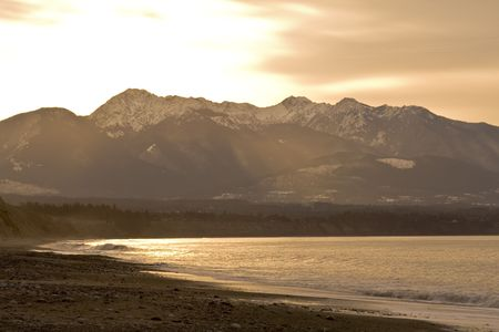 Beautiful winter dawn over the Olympic Mountains from the Dungeness Spit Stock Photo - 2985690