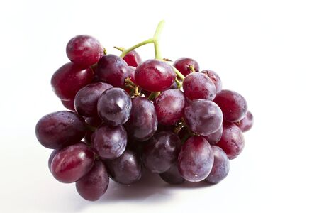 A bunch of fresh red grapes on a clean white background