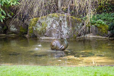 show garden: A small garden fountain shaped like a snail