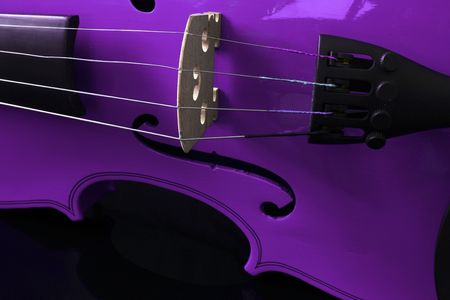 A close up of a purple violin on a black background Stock Photo