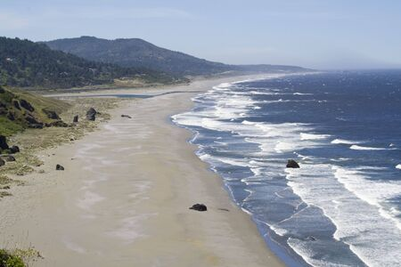 A beautiful Sandy beach along the Oregon Coast on a clear day Stock Photo