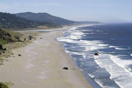 A beautiful Sandy beach along the Oregon Coast on a clear day Stock Photo