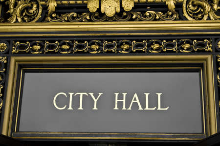 A city hall sign with ornate architectural details