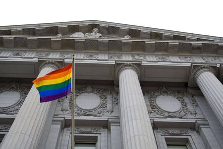 bisexual: Lesbian, gay, bisexual, and transgender pride flag flying outside a government building