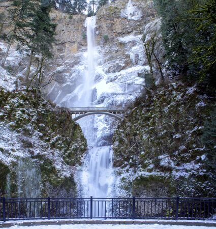 A panoramic view of Multnomah Falls frozen in winter