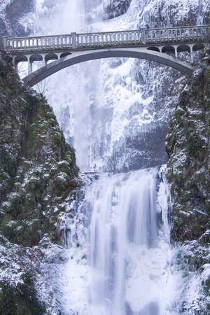 Multnomah Falls frozen in winter photo