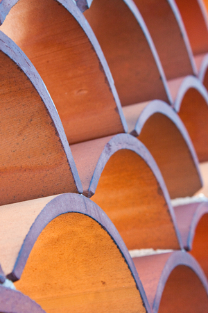 terra cotta: patterned terra cotta roof tiles Stock Photo