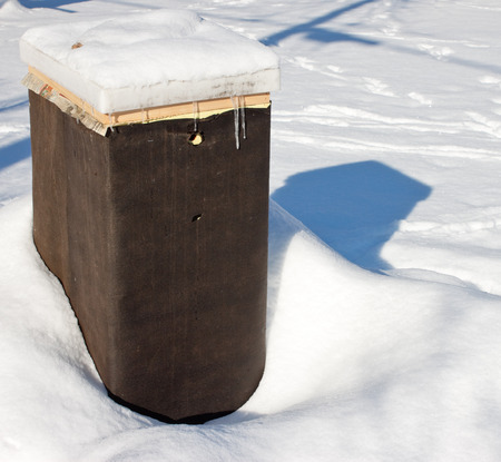 tar paper: A beehive wrapped in tar paper for over wintering Stock Photo