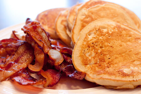 Homemade pancakes and bacon for breakfast