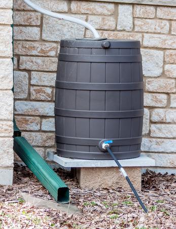A rain barrel set up to catch rain photo