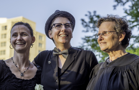 A lesbian couple getting married on the steps of the county courthouse after a judge struck down Wisconsin Editorial