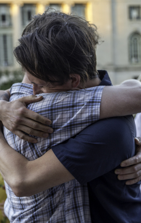 A gay couple getting married on the steps of the county courthouse after a judge struck down Wisconsin
