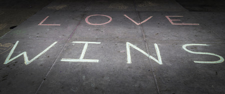 Love wins chalked on the steps of a court house