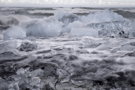glacial: Glacial Ice on the beach at Jokulsarlon, Iceland