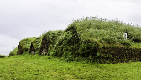 An old fashioned Icelandic house with a turf roof