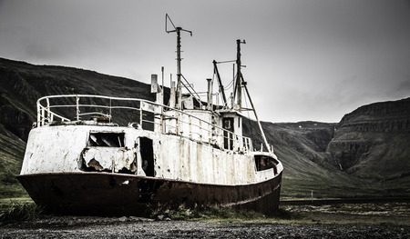 wreckage: The wreckage of an abandined ship sinks into the ground
