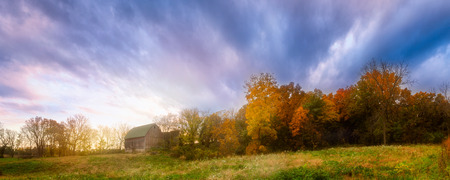 Sunset creates vibrant fall colors on this abandoned barn.