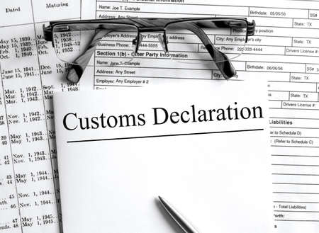 Paper with text Customs Declaration on a financial tables with glasses. Business and financial conzept 版權商用圖片