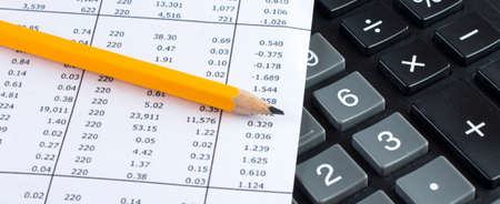Financial planning with calculator and pencil on data