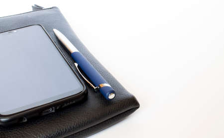 Black leather wallet with pen and mobile phone