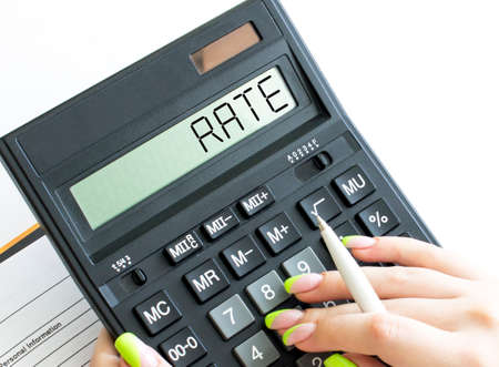 A calculator with text Rate on the display Stock Photo